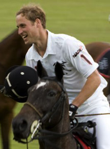 Preeppy Prince William plays polo in a polo shirt. Photo by Simon Taylor.