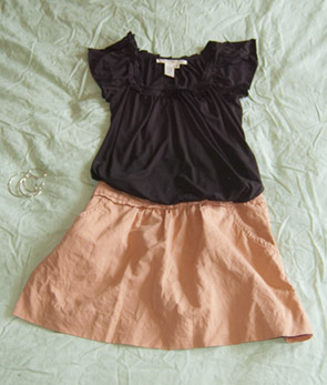 black short sleeve blouse and a pink cotton skirt